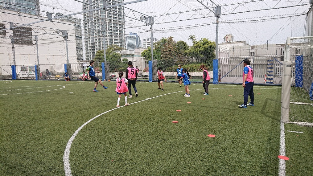 Photo of children playing futsal mixed with adults