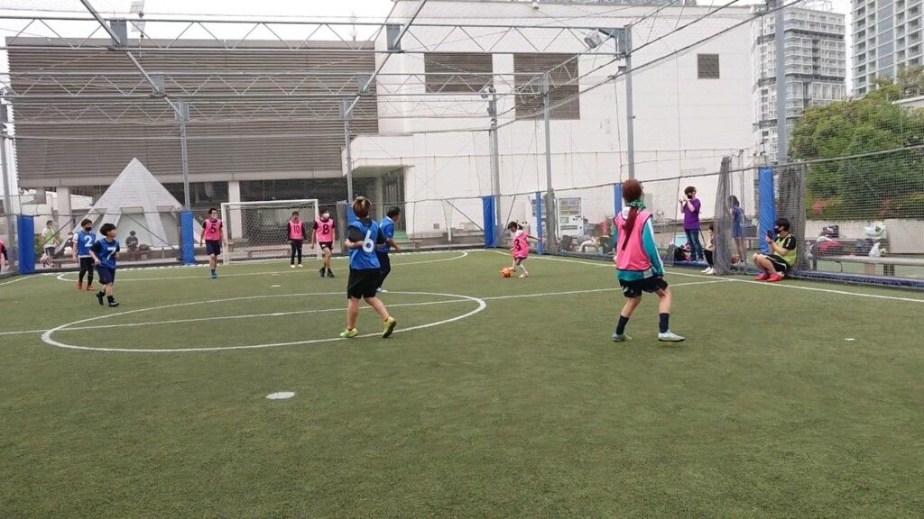 Photo of children doing futsal with adults